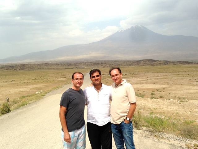 (Khatchig  Mouradian, Zulkuf, and Bohjalian near the western base of Mount Ararat. Photo by Victoria Blewer)