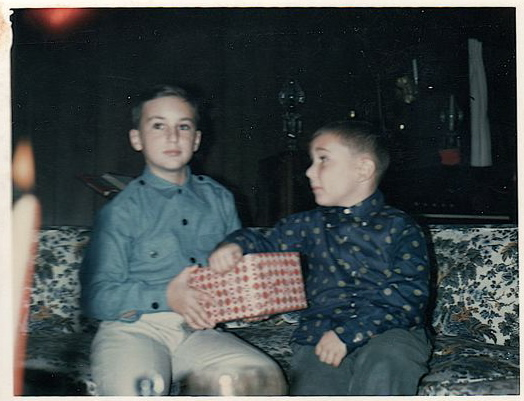 Chris, on the right, with his older brother Andy, on the left, when they were children one Christmas morning.